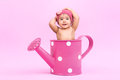 Flower baby beautiful inside a watering can all in pink Royalty Free Stock Photo