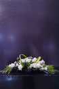 Flower basket the white rose on black rostrum Royalty Free Stock Photos