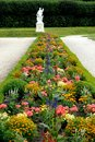 Flower bed and white statue in the park of the castle in germany bruhl photo taken at located near city cologne picture you see Royalty Free Stock Photo