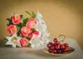 Flower bouquet and a bunch of grape on table Royalty Free Stock Photo