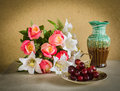 Flower bouquet and a bunch of grape on table Royalty Free Stock Image