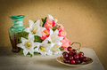 Flower bouquet and a bunch of grape on table Stock Image