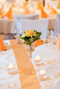 Flower bouquet in glass vase on dining table Royalty Free Stock Photo