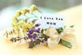 Flower bouquet with I love you mom text on card Royalty Free Stock Photo