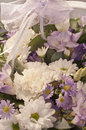 Flower bouquet with a lace ribbon beautiful of white lilac and purple flowers Royalty Free Stock Images
