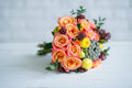 Flower bouquet with orange roses and yellow ranunculus Royalty Free Stock Photo