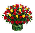 Wedding flowers, groom holds bouquet of white, blue, yellow flowers and red roses