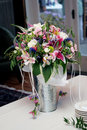 Flower bouquet in a silver vase Royalty Free Stock Photo