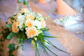 Flower bouquet  on wedding dining table Royalty Free Stock Photo