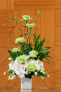 Flower bouquet in white ceramic pot of carnation orchid and chrysanthemum Stock Photo