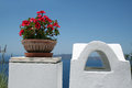 Flower bowl a red flowers from a hotel in firostefani village santorini greece Royalty Free Stock Photo
