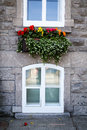 Flower box street scene of old quebec city is full work charm with its upper and lower towns full ornate stone and brick european Royalty Free Stock Image