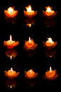 Flower candle on fire Royalty Free Stock Image