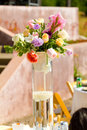 Flower center piece at wedding reception decor with pieces on tables Royalty Free Stock Images