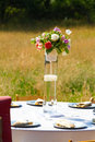 Flower center piece at wedding reception decor with pieces on tables Royalty Free Stock Image