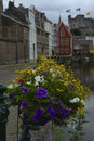 Flower decoration along a canal in the historic centre of ghent Royalty Free Stock Photo
