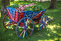 Flower decoration in the garden and wooden wagon Royalty Free Stock Photo