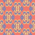 Flower design seamless pattern. Bright yellow and blue flower elements on salmon red background