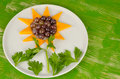 Flower dessert of grapes mango slices and served as a sunflower Royalty Free Stock Image