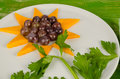 Flower dessert mango slices and grapes served as a sunflower Royalty Free Stock Images