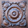 Flower engraved on the wooden portal of an ancient church. Royalty Free Stock Photo