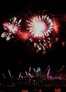 Flower fireworks over the cincinnati skyline red and white and former railway bridge spanning ohio river during riverfest Stock Images