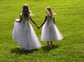 Flower girls holding hands Royalty Free Stock Photos