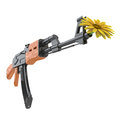 Flower in a gun as symbol for yellow machine pacifism Royalty Free Stock Photo