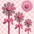 Flower lolly buttons over polka dots Stock Images