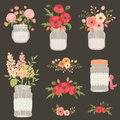 Flower in mason jars. Royalty Free Stock Photo