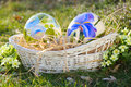 Flower painted eggs in a wicker basket easter and spring celebration Stock Images