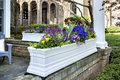 Flower pot on front porch of home Royalty Free Stock Photo