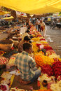 Flower sellers agra india april th a backlit market selling flowers for religious use Stock Photography