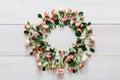 Flower shop background, roses circle on white wood Royalty Free Stock Photo