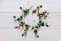 Flower shop background, roses circle on white wood