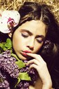 Flower shop. portrait of young woman, girl with beautiful lilac, orchid flower Royalty Free Stock Photo
