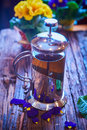 Flower tea in glass pot on a wooden table. Royalty Free Stock Photo