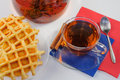 Flower tea with waffles and cinnamon Royalty Free Stock Photography
