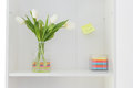 Flower vase with colourful post it white tulips in a colored a smiley face drawed on a yellow Stock Images