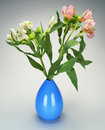 Flower vase flowers in blue on grey white Stock Images