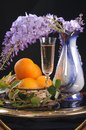 Flower, wine and oranges. Stock Photo