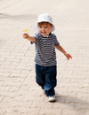Flower for you adorable toddler offering a while walking the pedestrian street Royalty Free Stock Photo