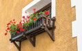 Flowered balcony small in an alps village Royalty Free Stock Images