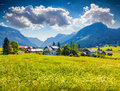Flowering meadows around Gosau village at summer sunny day Royalty Free Stock Photo