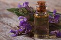 Flowering sage and fragrant oil horizontal close up on the table Royalty Free Stock Photography