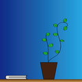 Flowerpot and book Stock Image