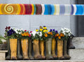 Flowerpot boots recycled used as flowerpots with colourful flowers and banner Royalty Free Stock Photo