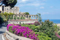Flowers and ancient architecture in Taormina at Sicily, Italy Royalty Free Stock Photo