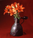 Flowers in antique vase Royalty Free Stock Photo