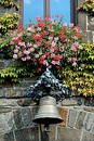 Flowers and bell above entrance to City Hall in a German village Stock Photo